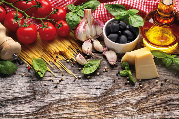 Italian food ingredients on wooden background